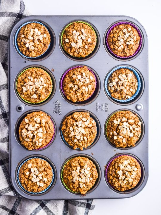 banana oatmeal muffins in a muffin pan with colored silicone muffin cups