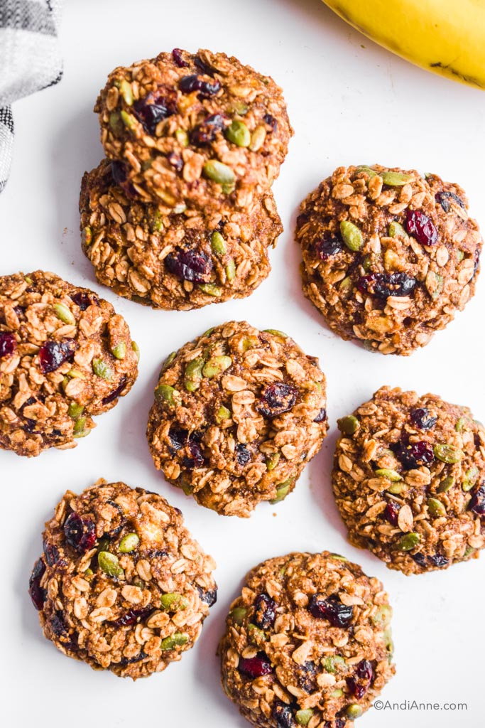 banana cranberry breakfast cookies on white table with bananas in top right corner