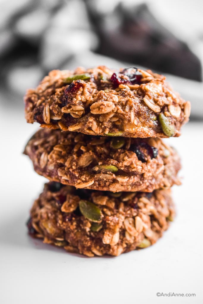 three stacked breakfast cookies on top of eachother with white background