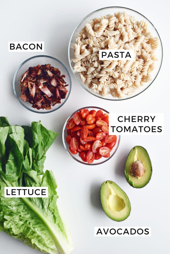 ingredients in separate bowls on white counter
