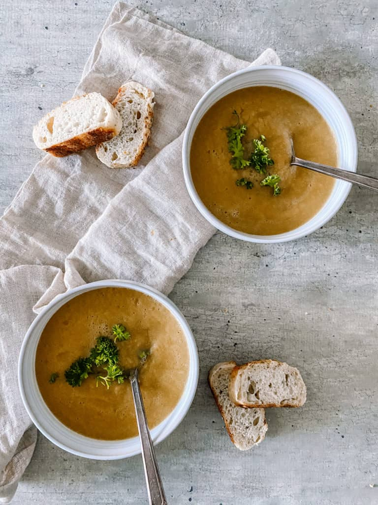 crockpot freezer meal budget friendly frozen vegetable soup recipe served in bowls with cruncy bread