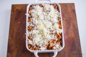 mozzarella cheese sprinkled on top of pasta mixture