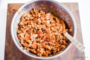 pasta, sauce and ground beef in a steel bowl