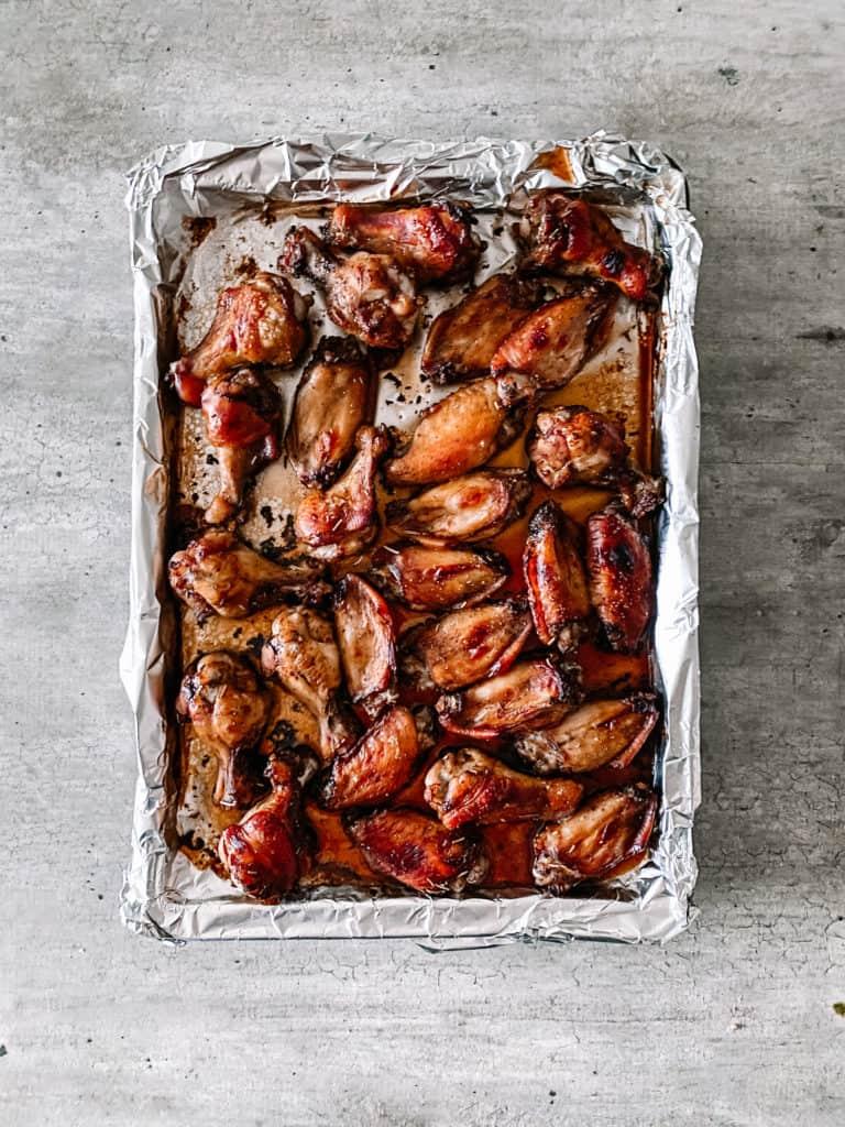 balsamic glazed chicken wings on a baking sheet
