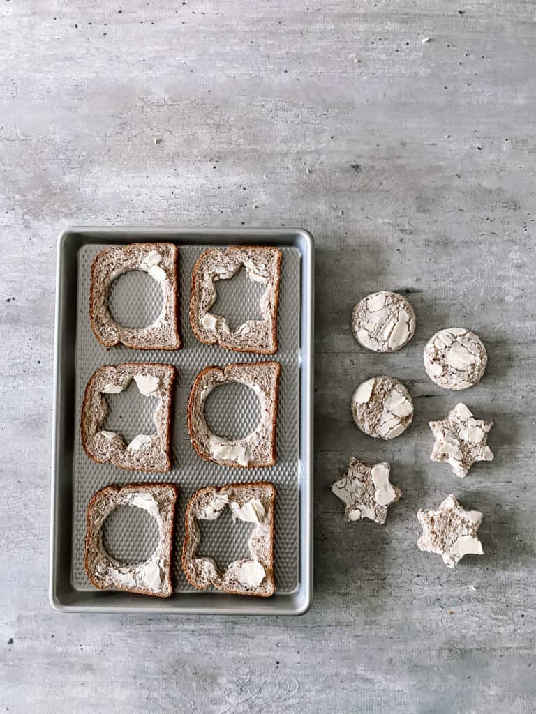 pieces of bread with the centers cut out in circle and star shapes