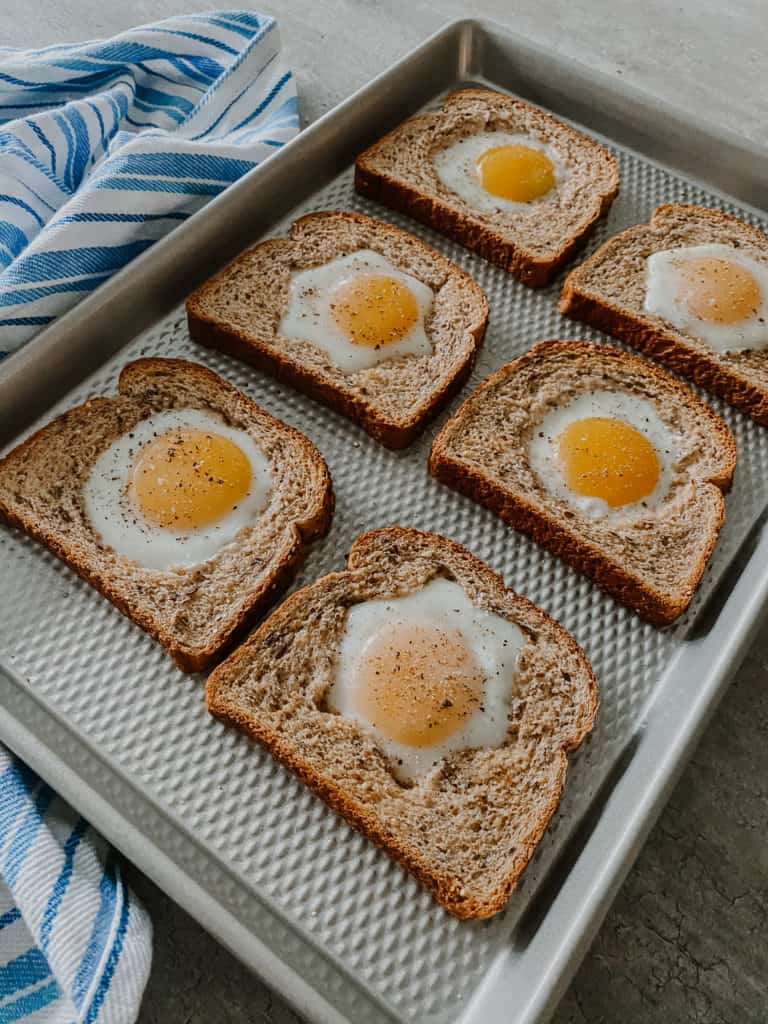 Baked Eggs In A Hole on a sheet pan