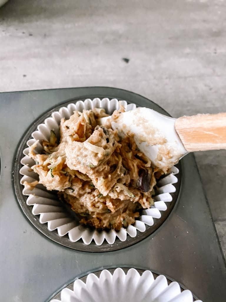batter in paper cupcake liner in muffin pan