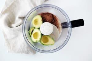 avocados, cocoa powder and coconut milk in a food processor