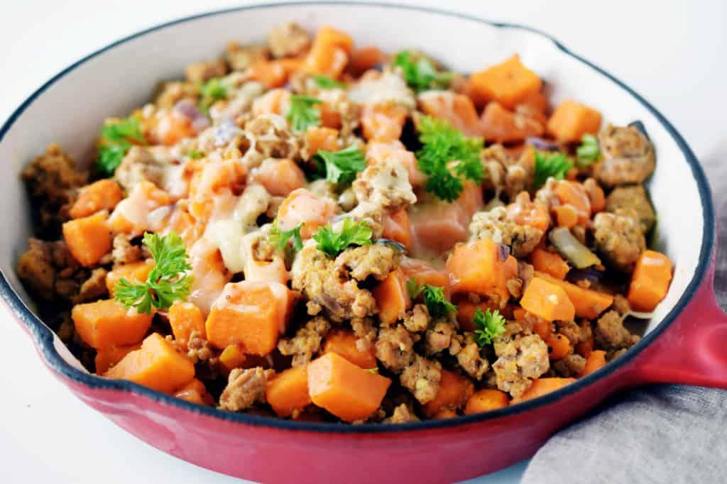 ground turkey sweet potato skillet in red enamelled pan