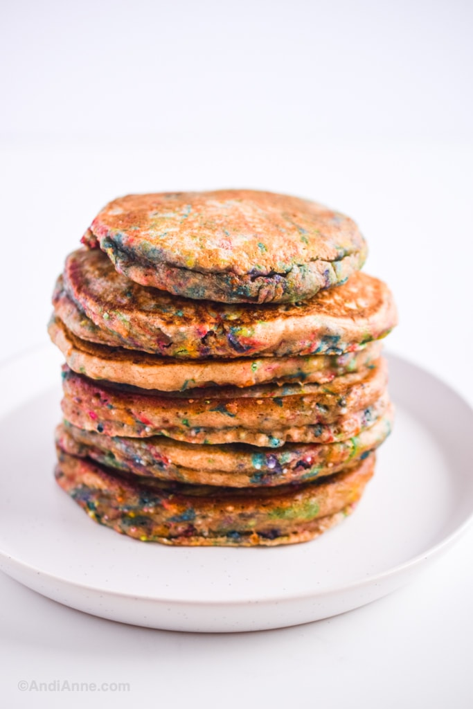 stack of sprinkle pancakes on a white plate