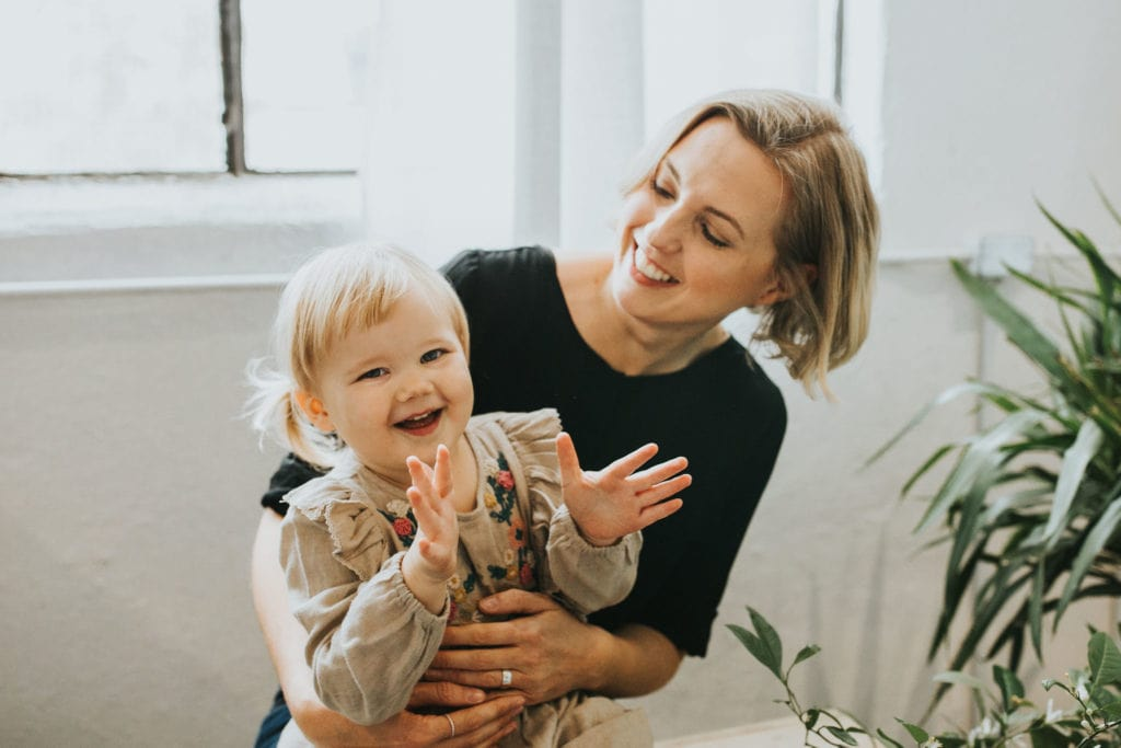 Picture of Andi and her daughter laughing together