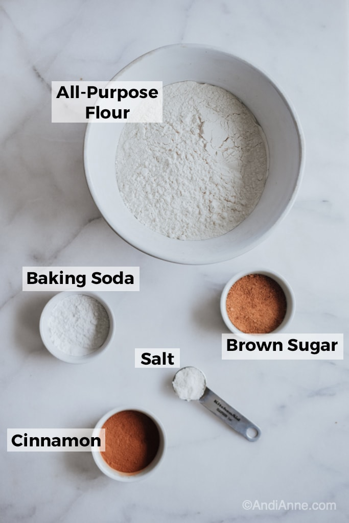 ingredients in white bowls on a marble counter
