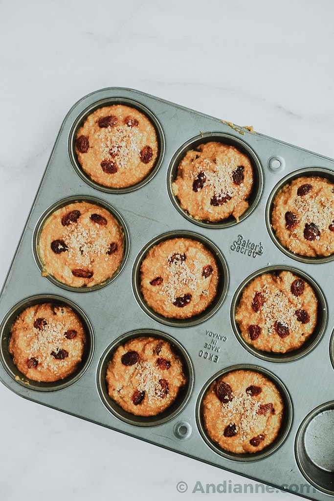 classic raisin bran muffins in a muffin tin before cooking