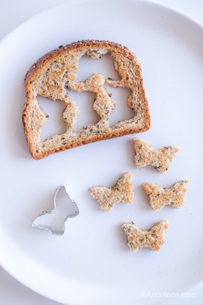 butterfly shapes cut out of toast with a mini cookie cutter