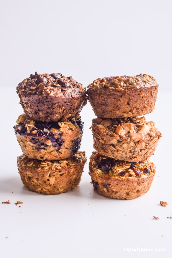 baked oatmeal breakfast cups stacked in three's on a counter