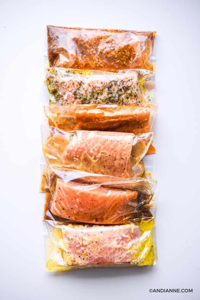 salmon marinades in plastic bags stacked beside eachother