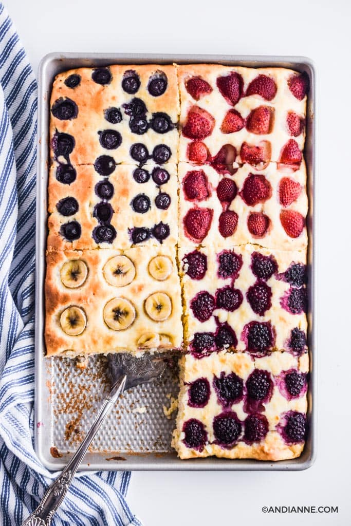 sheet pan pancakes in a baking sheet with silver spatula and blue striped napkin on side