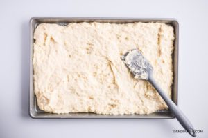 pancaked batter smoothed over sheet pan with a spatula