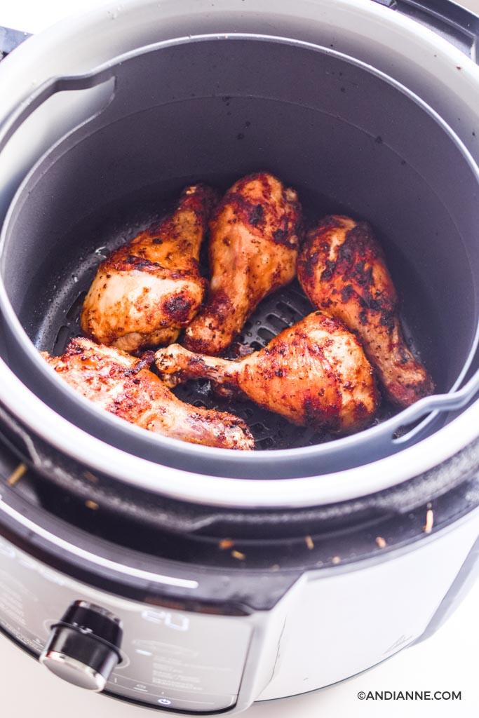 cooked chicken drumsticks in an air fryer