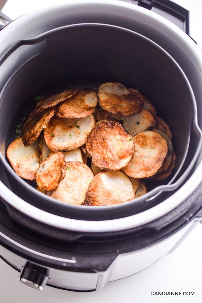 crispy potato chips in a black air fryer
