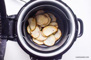 sliced potato in an air fryer