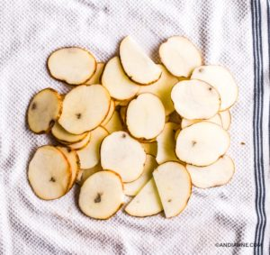 sliced potatoes on a white dish towel