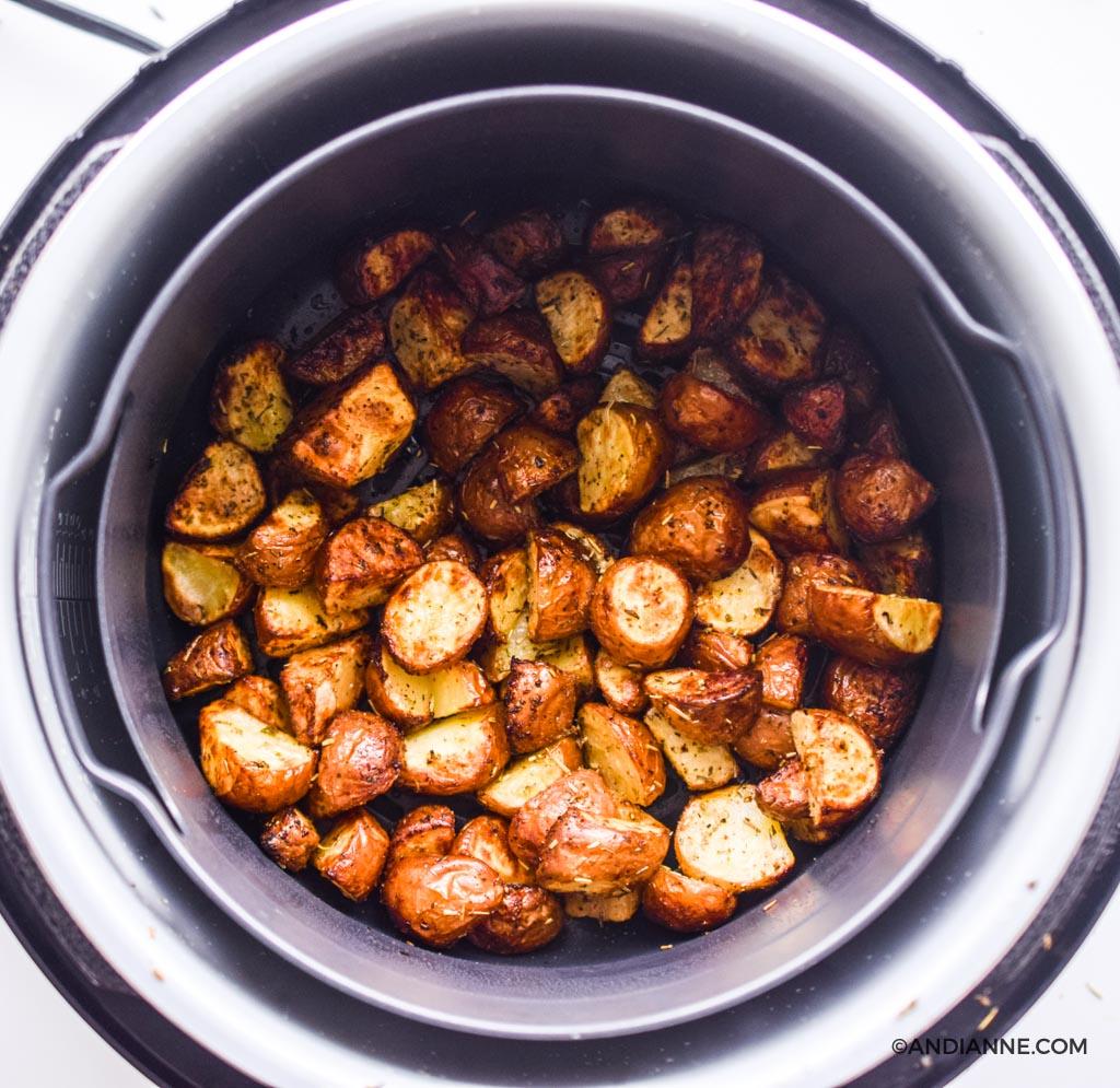 cooked crispy potatoes inside an air fryer