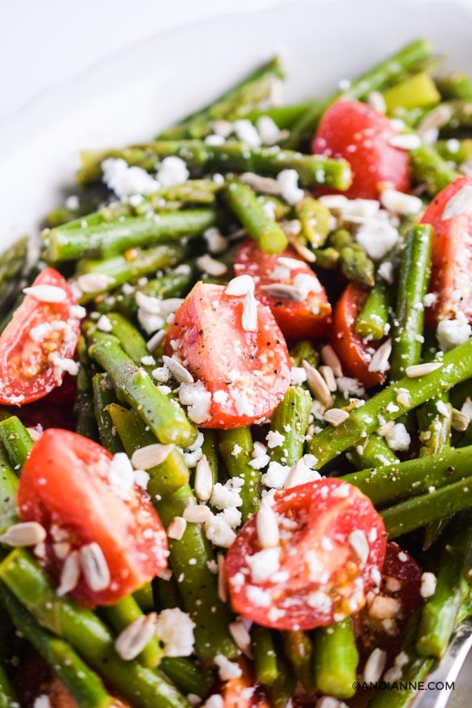 close up of tomatoes, asparagus, feta salad