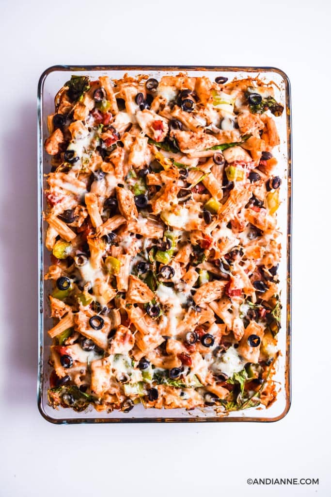 Cooked chicken olive pasta bake in glass casserole dish