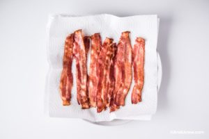 cooked bacon on paper towel