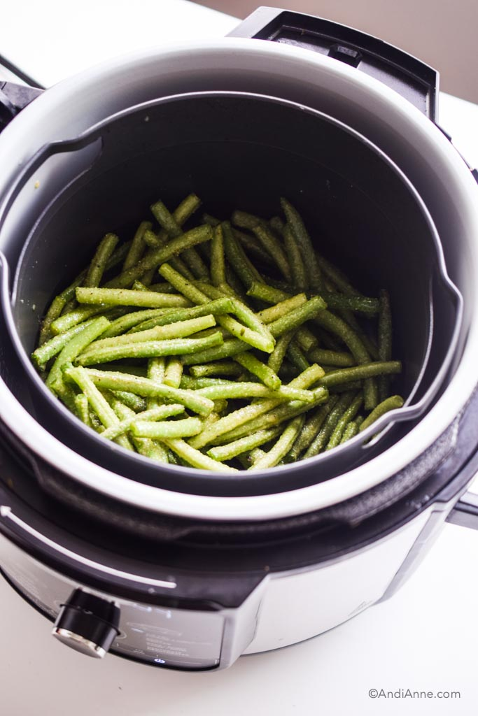 seasoned green beans in an air fryer