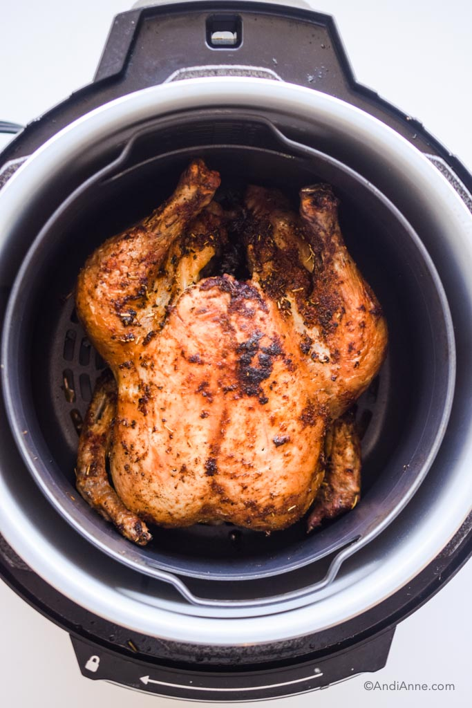 fully cooked chicken inside an air fryer