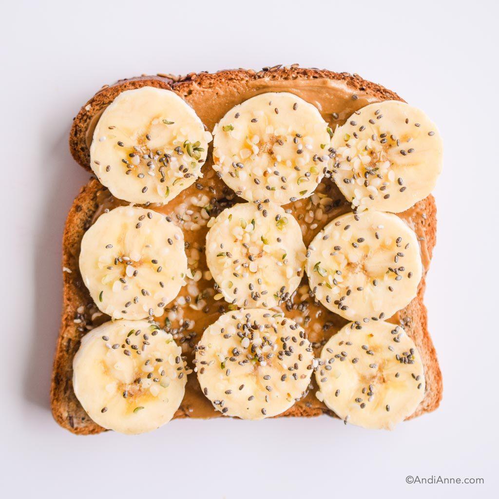 nut butter on toast with hemp seeds and sliced banana