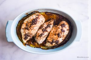 3 cooked chicken breasts in blue oval baking dish