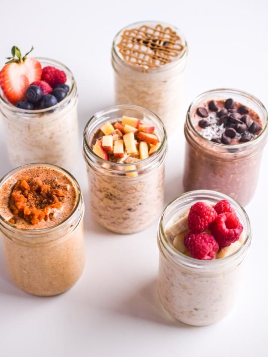 six healthy overnight oat recipes with fresh toppings like apple, raspberries, chocolate chips.