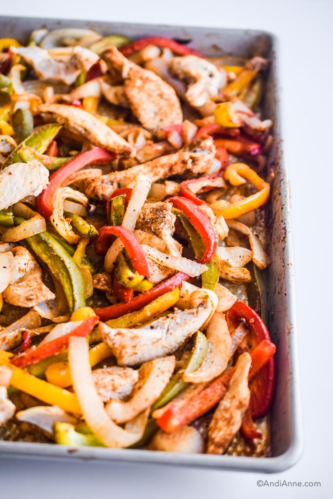 close up detail of sheet pan fajitas after they're cooked on the baking sheet