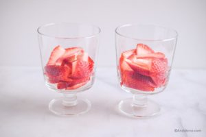 sliced strawberries in two glass cups