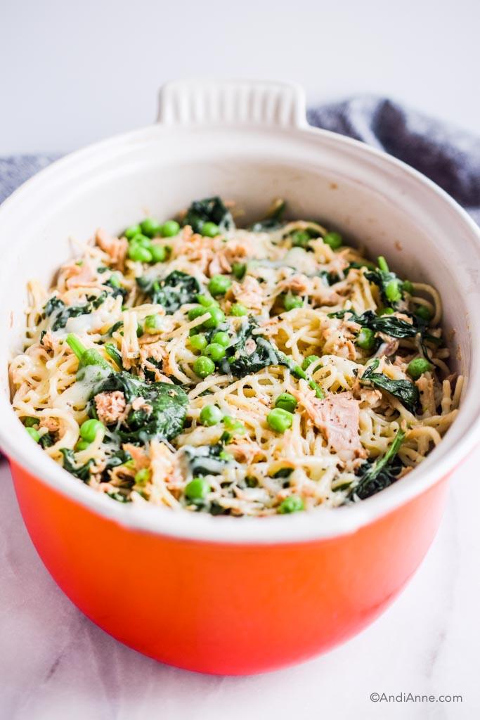 Orange oval bowl with white inside and tuna noodle casserole recipe