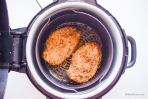 cooked parmesan chicken breasts in an air fryer