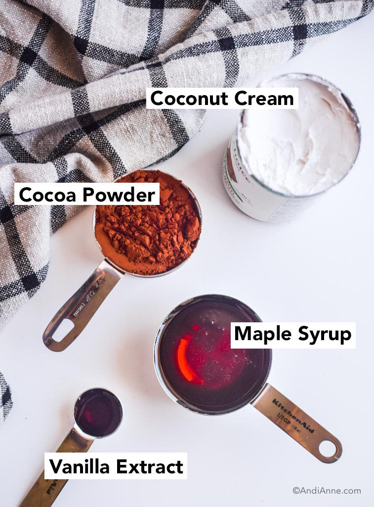 ingredients for homemade fudgesicles - canned coconut cream, cocoa powder, maple syrup and vanilla extract