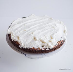 whipping cream on a single layer of cake