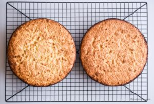two cooked cakes on a cooling rack