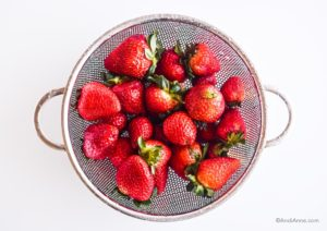 strawberries in a strainer
