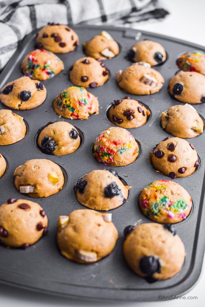 cooked pancake mini muffins inside a muffin pan