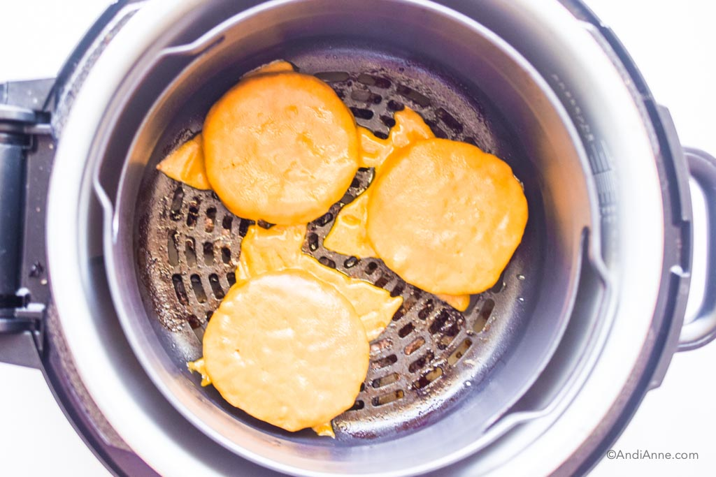 burgers with melted cheese in an air fryer