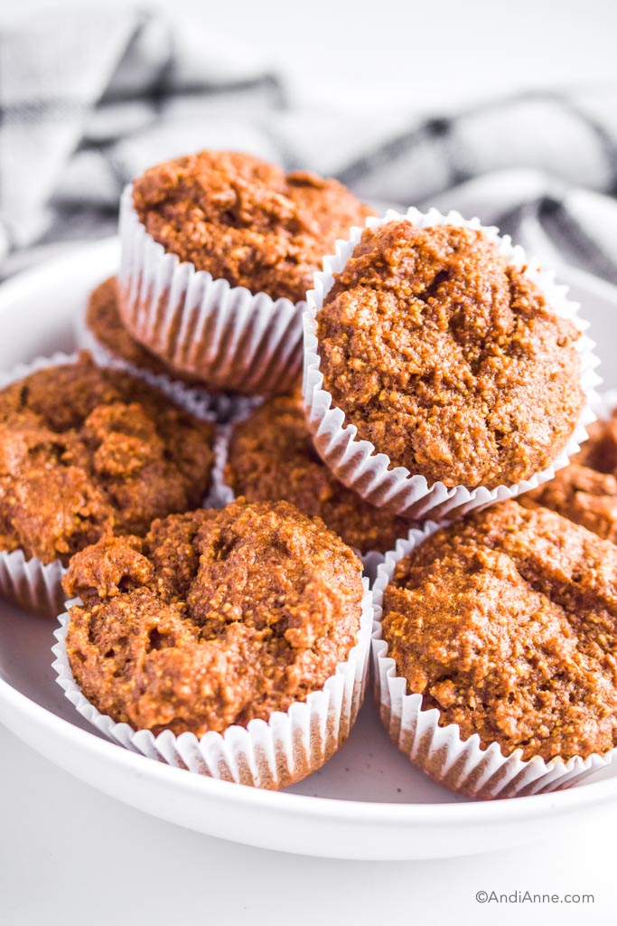 A pile of breakfast flaxseed muffins in a white bowl.