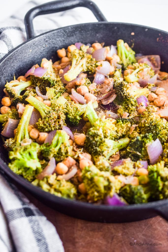 close up detail of broccoli chickpea stir fry in a frying pan