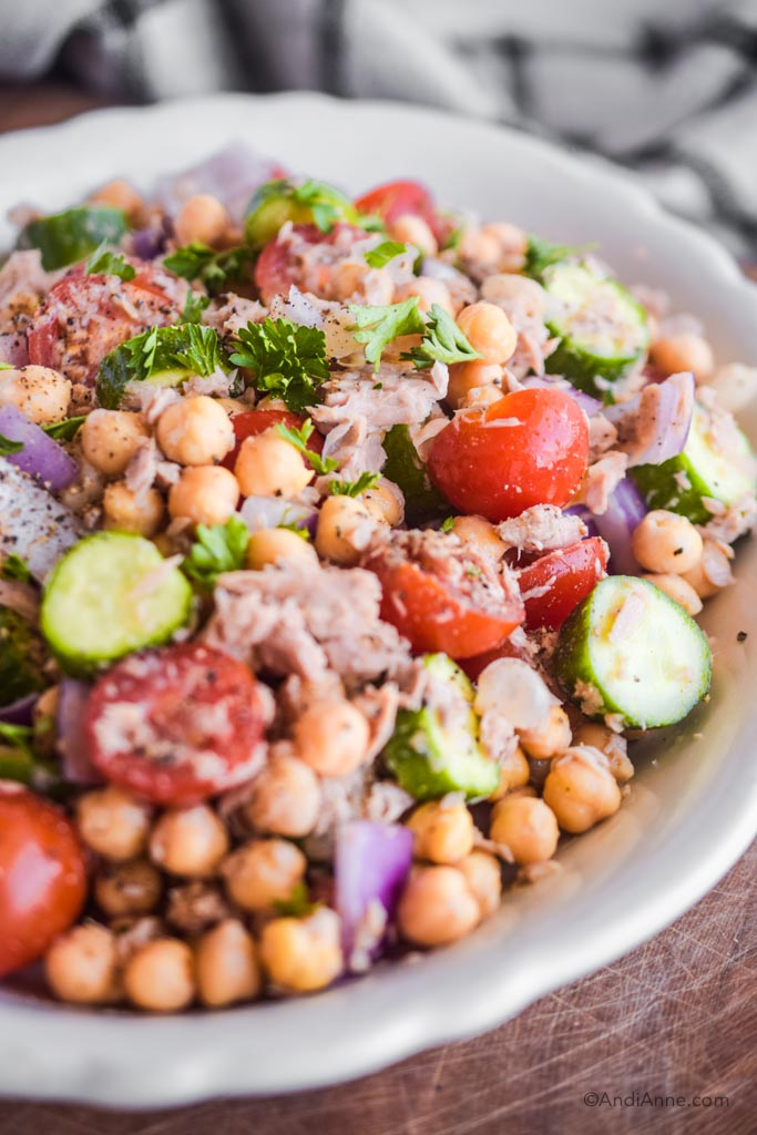 close up of chickpea lemon tuna salad in a white bowl