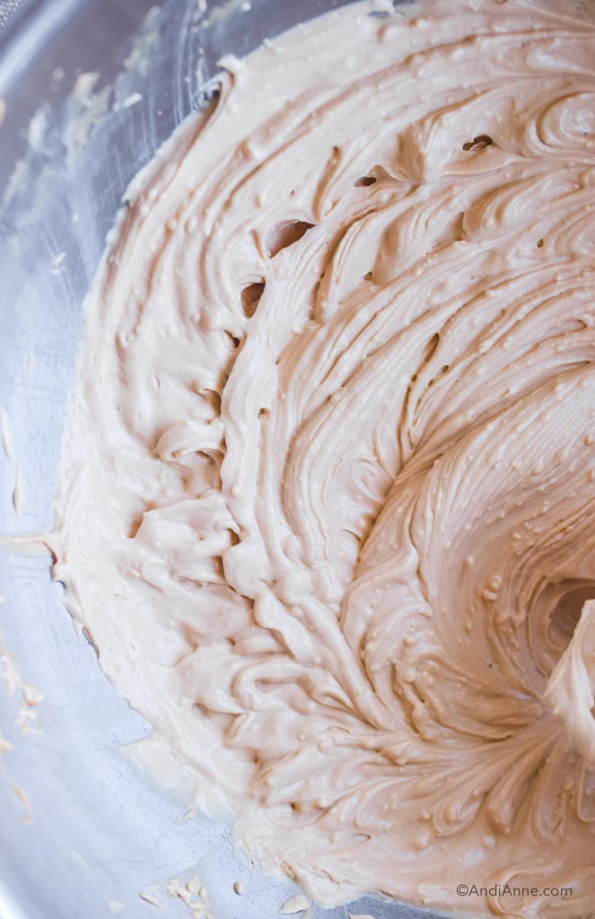 close up of smooth creamy cream cheese frosting in
