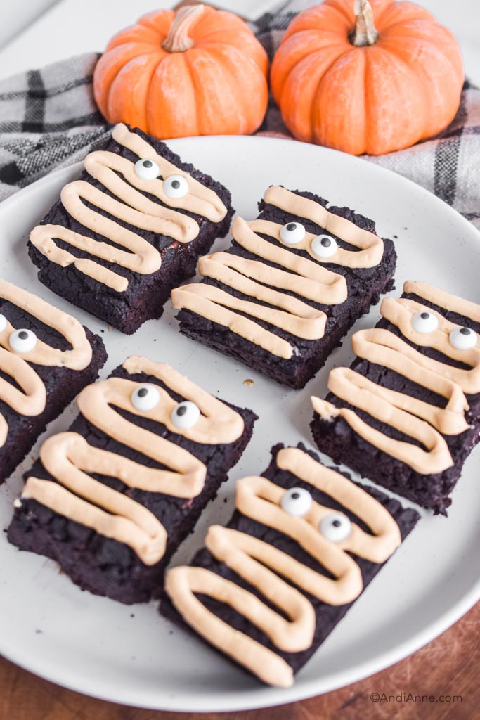 Side angle of the halloween chickpea brownies on a white plate.